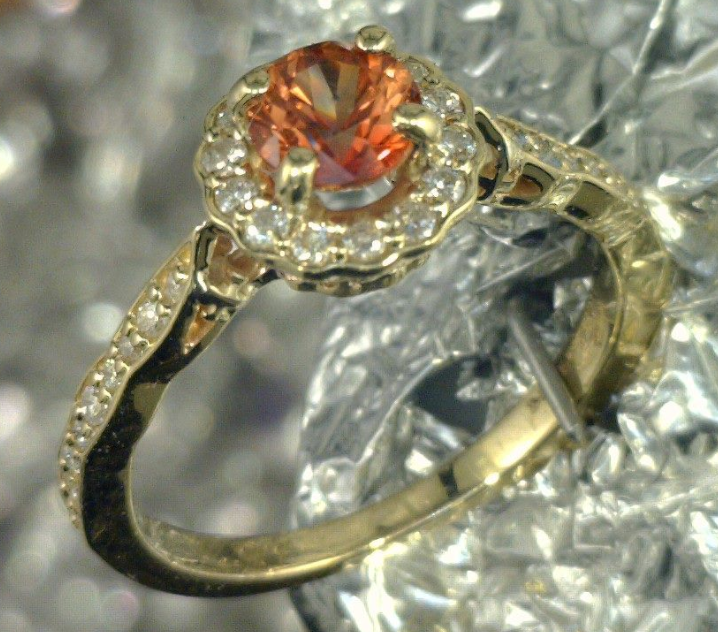 18k Yellow gold and diamond ring with a orange Sapphire center stone_.png