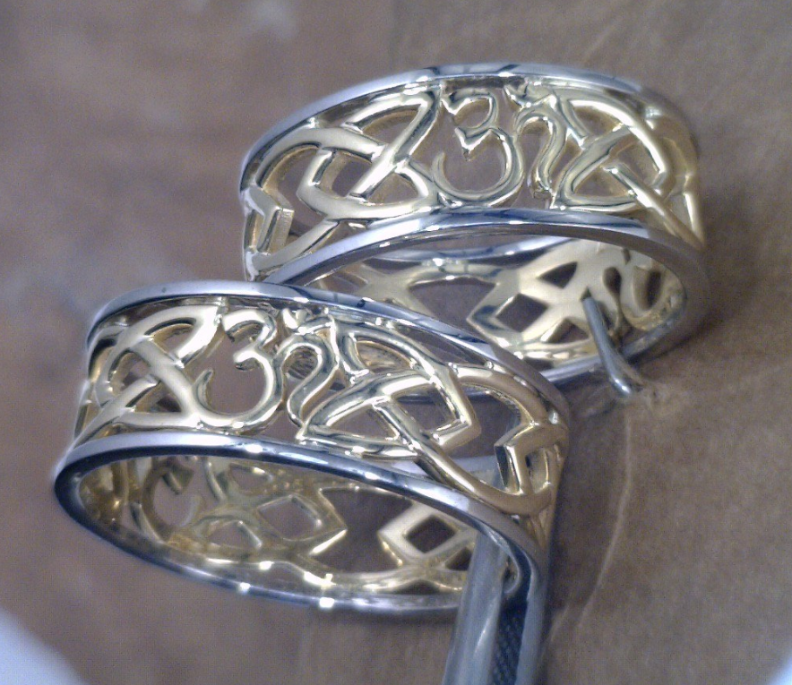 14k Yellow and white gold matching bands with celtic design with ohm symblol.png