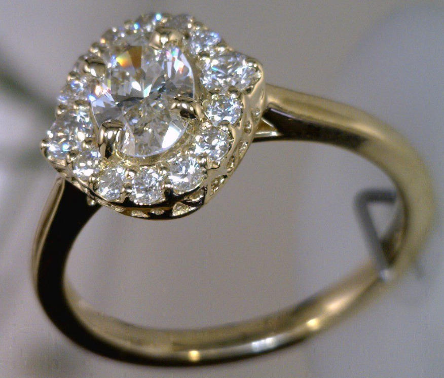 18k Yellow gold cluster ring with 1 carat oval diamond center stone.png