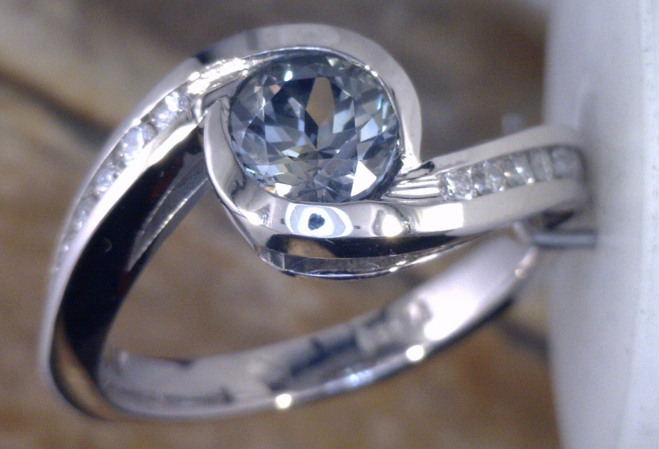 Bypass ring with 1 carat Montana Sapphire and side diamonds in Palladium.png