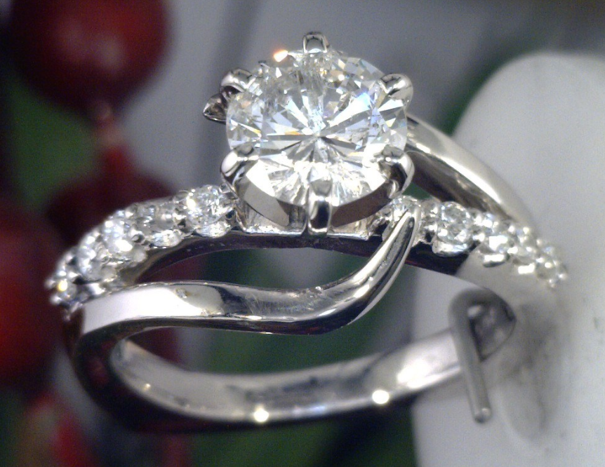 Bypass type diamond ring cast in Palladium.png