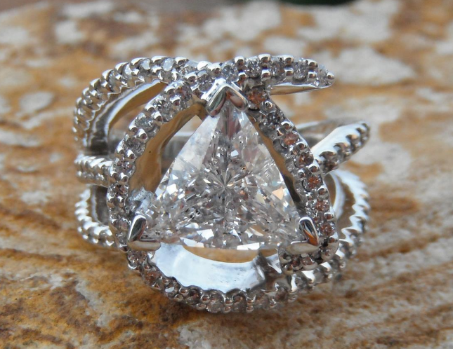 Cluster diamond ring with 2.0 carat trillion cut diamond.png