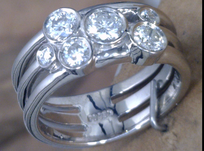 Cluster bezel set diamond ring.png
