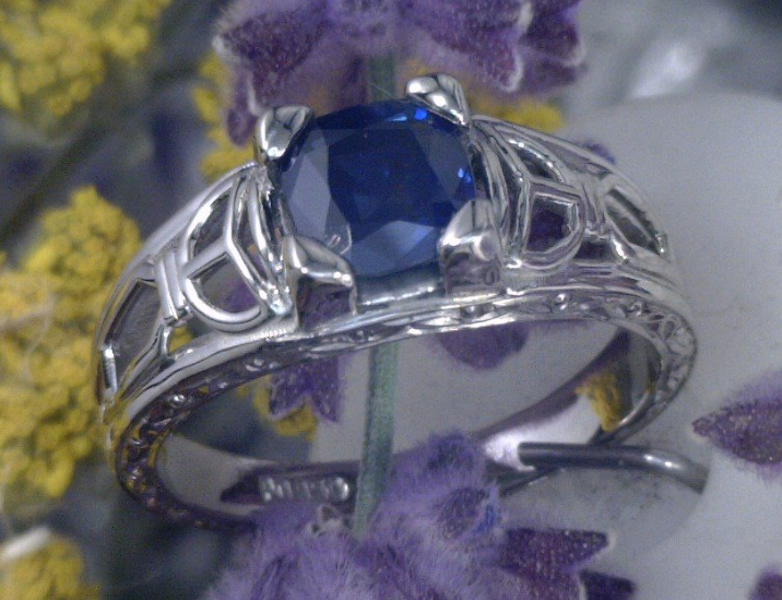 Cushion cut sapphire in filagree setting.png