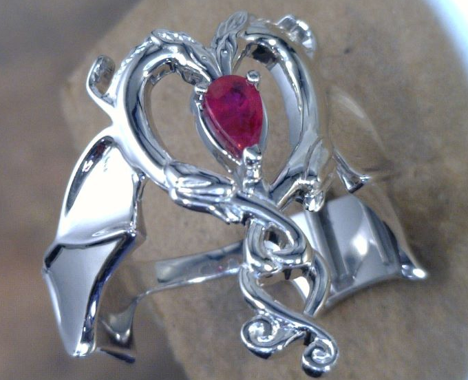 Dragon ring with Pear shape Ruby in Palladium.png