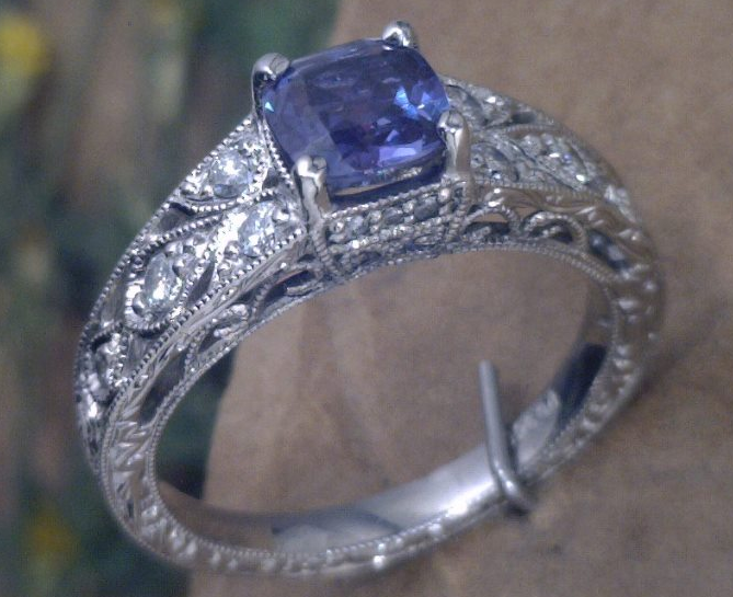 Filagree palladium and diamond ring with Cushion cut Lab grown, color changing  Alexanderite  center stone.png
