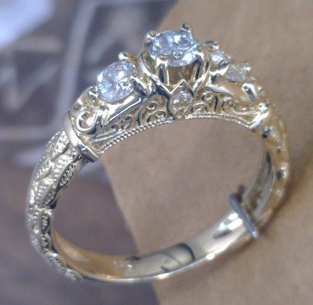 Filagree Yellow gold and diamond ring.png