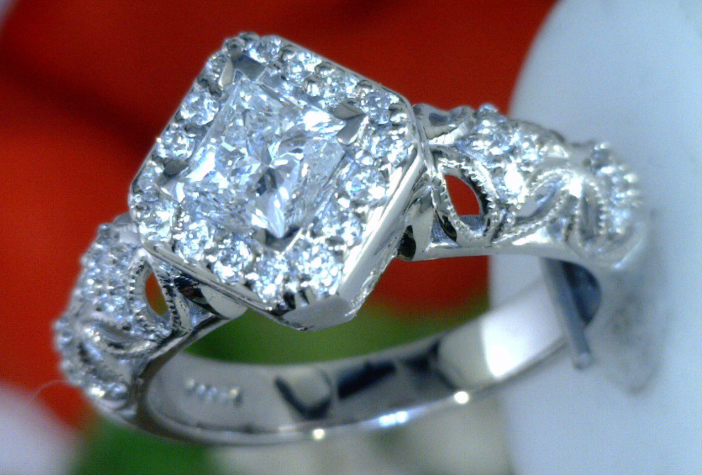 Halo ring with Princess cut center diamond.png