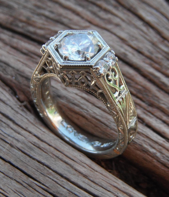 Hand engraved hexigon ring with 3_4 ct. diamond center.png