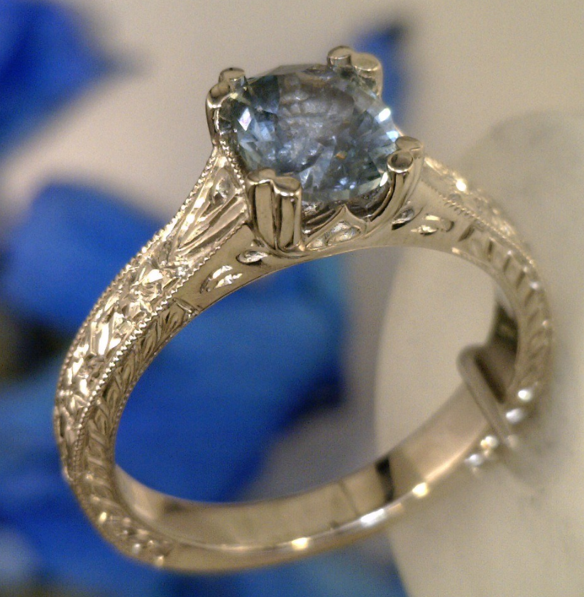 Montana sapphire in Hand engraved solitaire.png