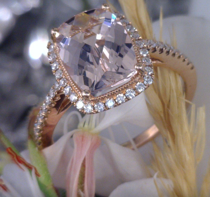 Morganite center stone with diamond halo and band.png