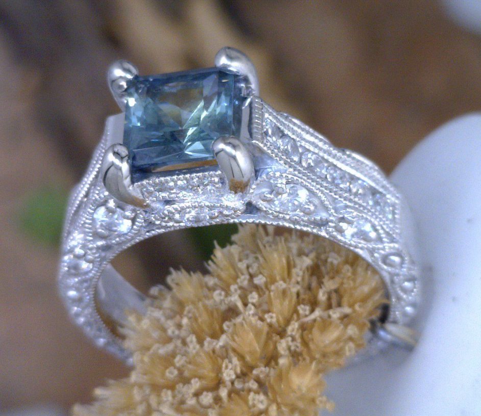 Palladium and diamond engagement ring with square Montana Sapphire.png