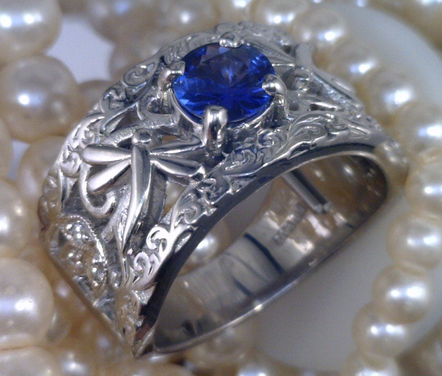 Palladium dragonfly ring with 3_4 ct. blue Sapphire.png