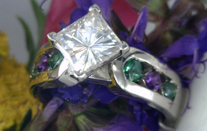 Palladium ring with Square Moissanite center and green and purple quartz side stones.png