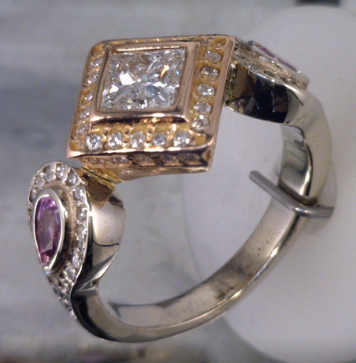 Rose and white gold with a pricess cut center diamond with pear cut pink sapphires.png