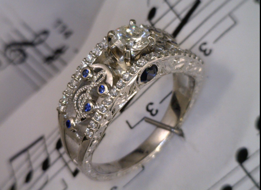 Treble and Bass clef ring with diamonds and two sapphires in palladium.png