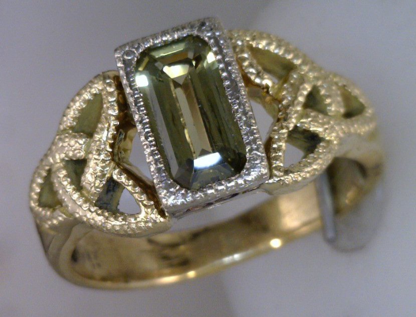 Trinity know 18k yellow and white gold ring with Yellow Sapphire.png