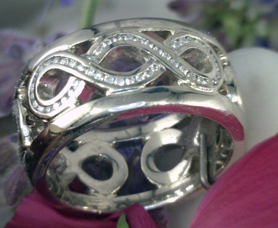 Triple infinity wide wedding band with diamonds in Palladium.png