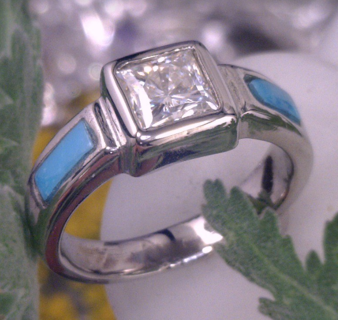 Turquoise inlay with pricess cut center stone cast in palladium.png