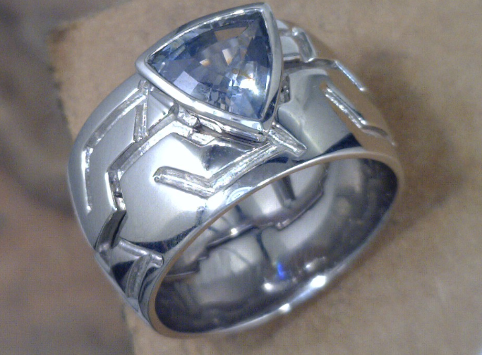 Two piece puzzle ring with Trillion cut Montana Sapphire.png