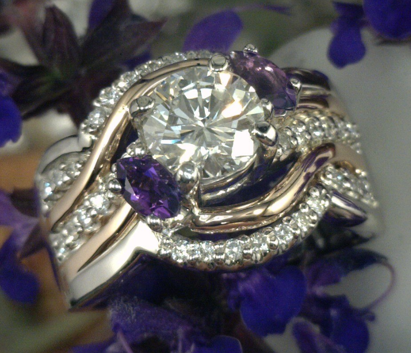 White and yellow gold with 1.25 carat center diamond and 2 Marquise Amethyst side stones.png