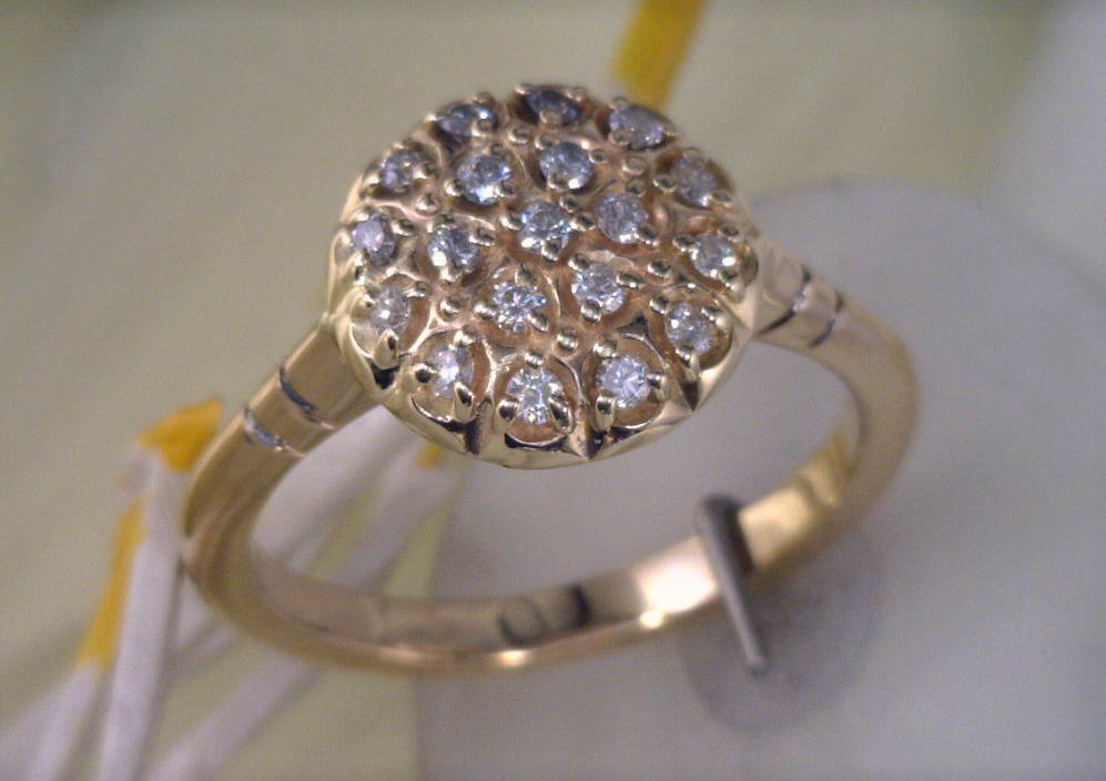 Yellow gold cluster diamond ring.png