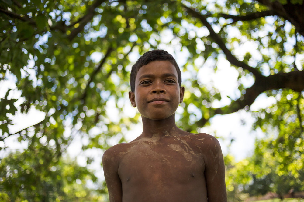 A young boy in the remote village of Pedtali, in the forests of Mahan.