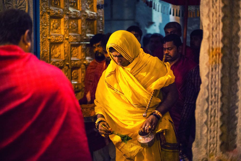 Gyanendra A, the head priest at the Dharmarayaswamy Temple and also the ordained bearer of the Karaga this year is seen performing a series of rituals at the temple, hours before he lifted the Karaga.