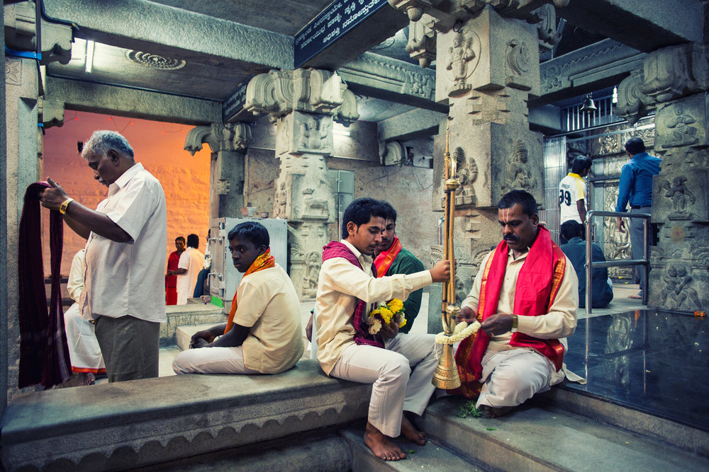 The calm environs of the Dharmarayaswamy Temple much before the crowds start pouring in. A couple of banka dasaiahs – an order of priests, wearing the ceremonial red shalya, prepares the traditional bugles called banka, the sound of which announces the arrival of the Karaga as it moves around.