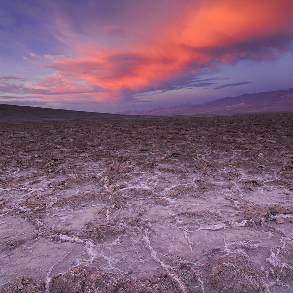 Welcome to Death Valley. As North America's lowest point, the Badwater Basin Salt Flats receives just 60mm of rain per year. I photographed this image in the early morning before sunrise. The flats are absolutely silent to the fact that the silence, itself, becomes loud. July 14, 2014 Nikon D810, 16mm f11, 0.3sec ISO 64 #deathvalley #photo #art #beautiful #instagood #california #photooftheday #photography #nature #aovmobile #folkgood #NikonNoFilter #modernoutdoors #landscape #justgoshoot #theoutbound #worldtravelbook #theIMAGED #earthofficial #awesome_earthpix (at Badwater Basin, Death Valley)