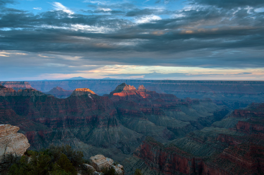 Grand Canyon photographed at Sunset. There are few things that can make a person feel as small as the Grand Canyon. It really brings out the realization that we are a just a small piece in a very large equation.