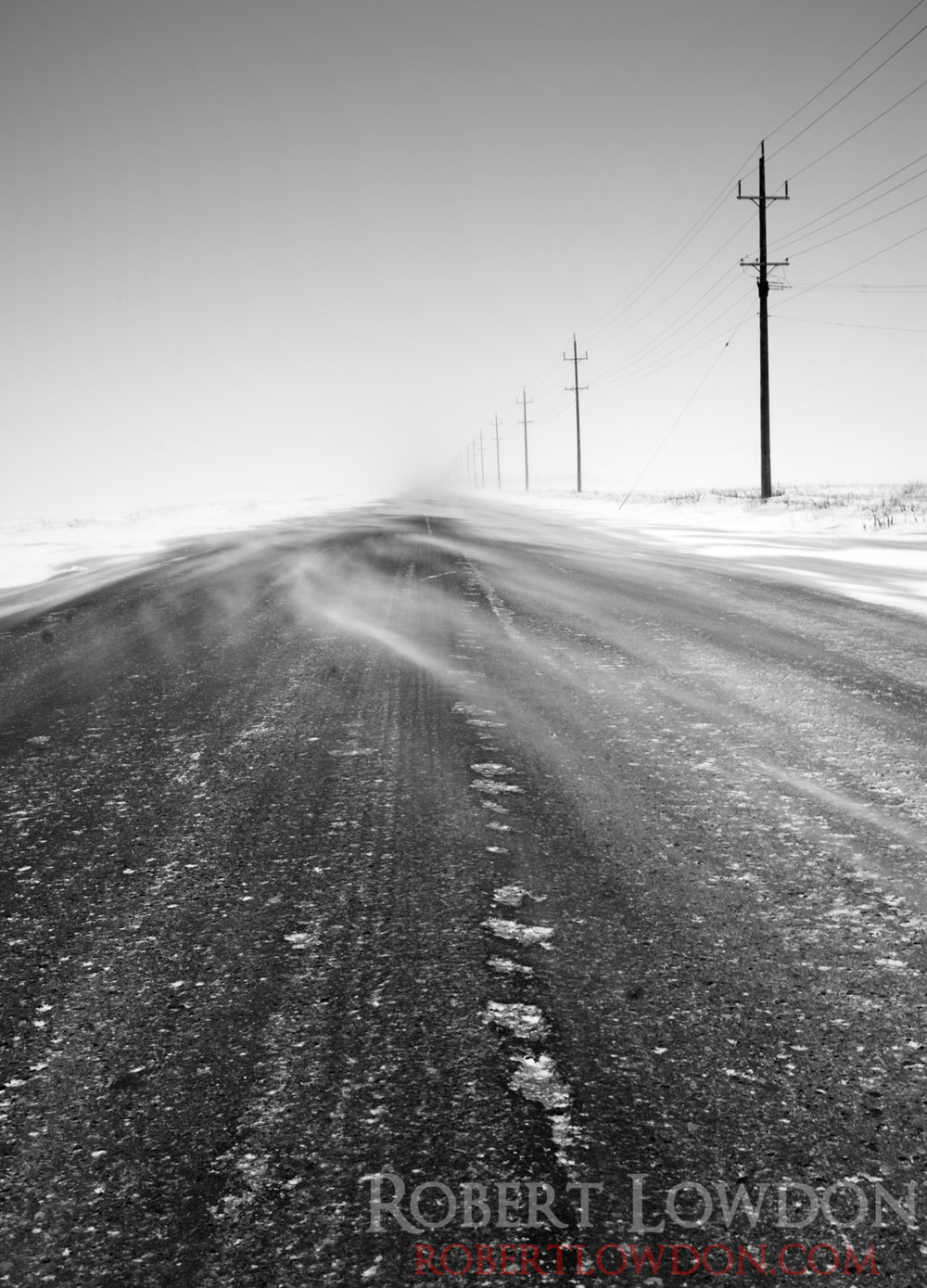 Winter on the Prairies.   Hey sometimes it's just a lonely long cold road. Pun most definitely intended.