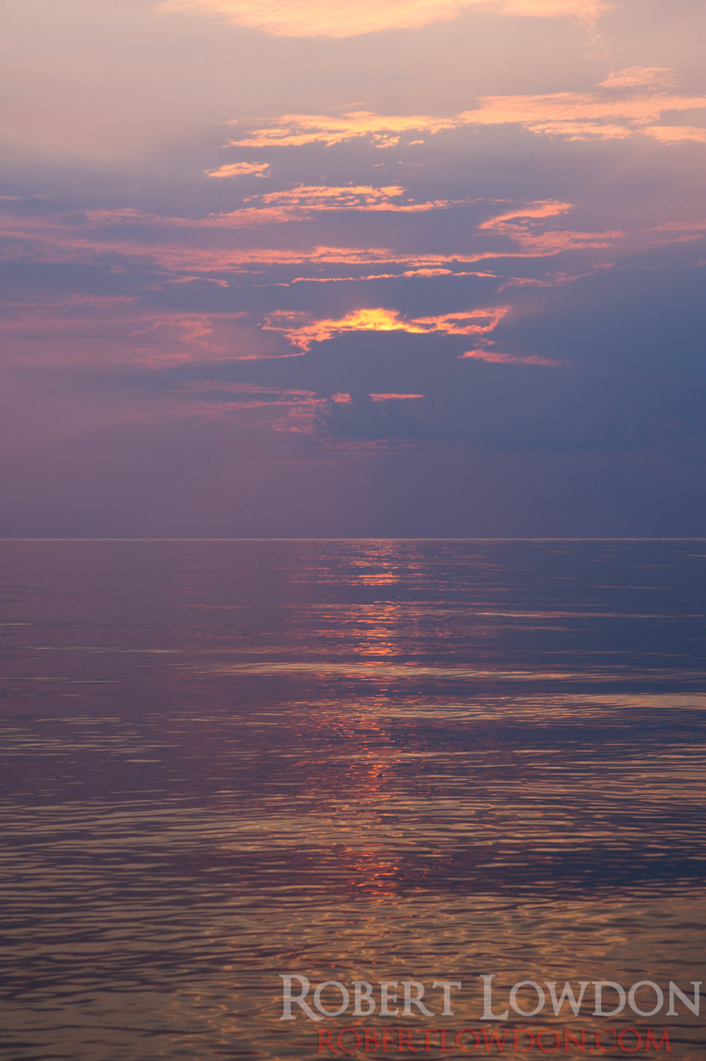 Water and Sun. Remembering warming times. Photograph taken on Lake Manitoba. Late August.