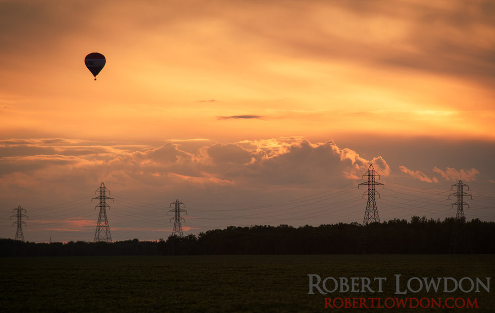 The Great Winnipeg Balloon Attack. By: Robert Lowdon The sun sets over the prairies with a hot air ballon in the background