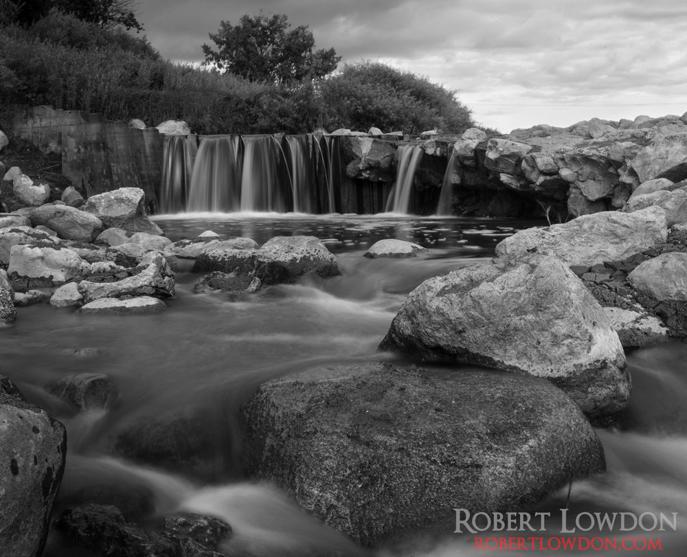 Into the River. By: Robert Lowdon Long exposure photograph taken near hwy 59 south of Winnipeg