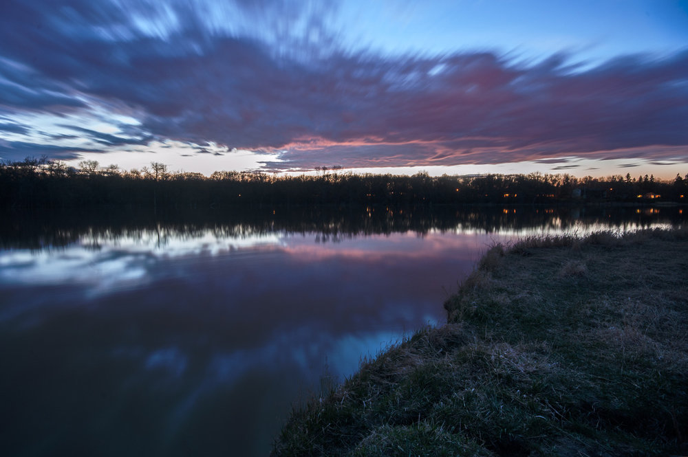 After Dark on the Red River By: Robert Lowdon Long Exposure photograph overlooking the Red River, Winnipeg MB, Canada