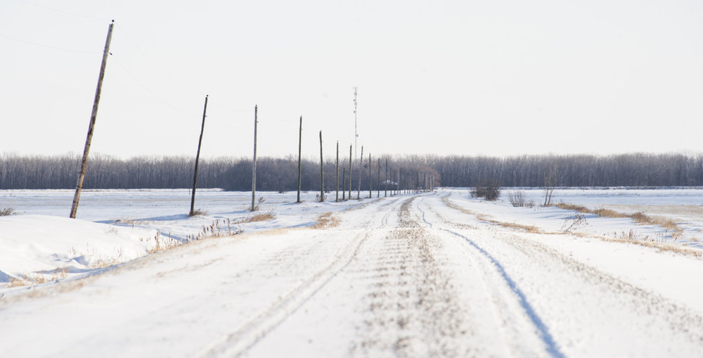 An old gravel road in the cold winter. © Robert Lowdon