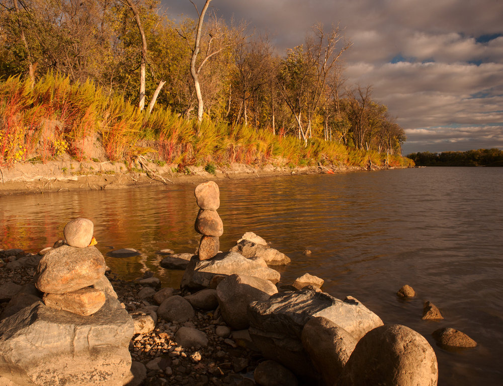 Rock Statues.      By: Robert Lowdon    On the banks of the Red River in Winnipeg, MB
