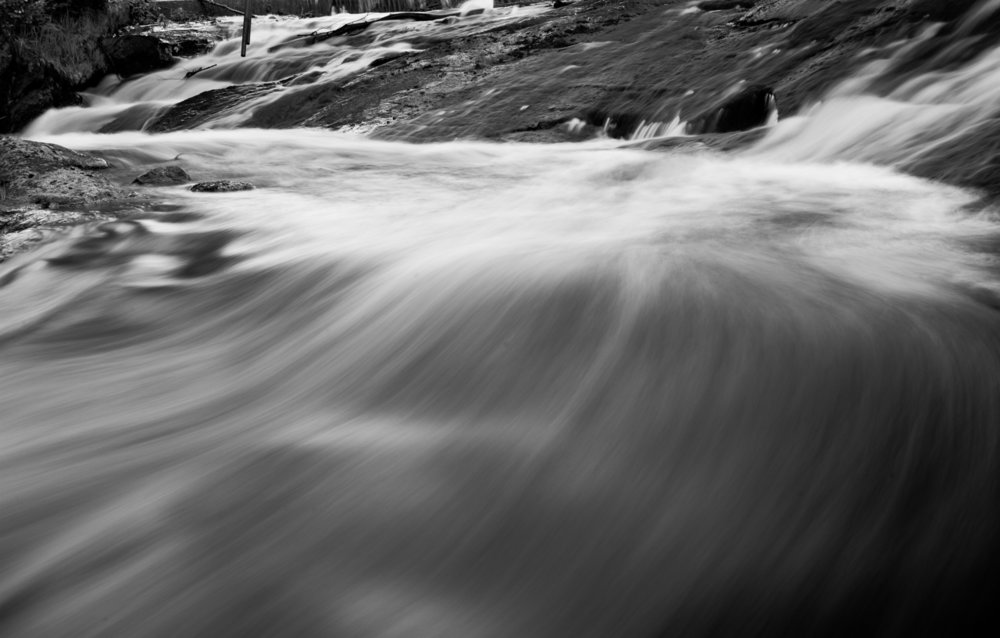 Moving Water By: Robert Lowdon Long exposure photograph of fast moving water.