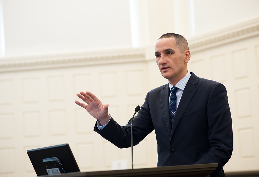 kevin chief speak to a crowd in this event photograph