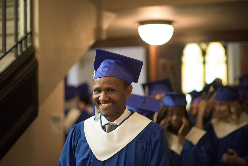 This medium close-up shot focuses on a graduate's facial expression. Photographs of individual students help to illustrate the personalized experience offered to CDI students.