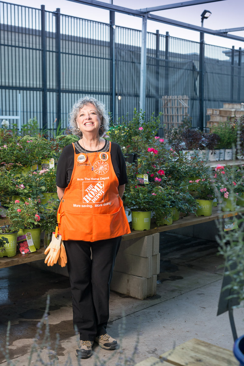 An employee of the home depot poses for a photograph. © Robert Lowdon