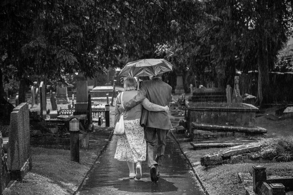 old romantic couple in the rain