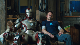 Robert Downey Jr. (right) with his suit in Iron Man 3. (The_JIFF / Flickr)