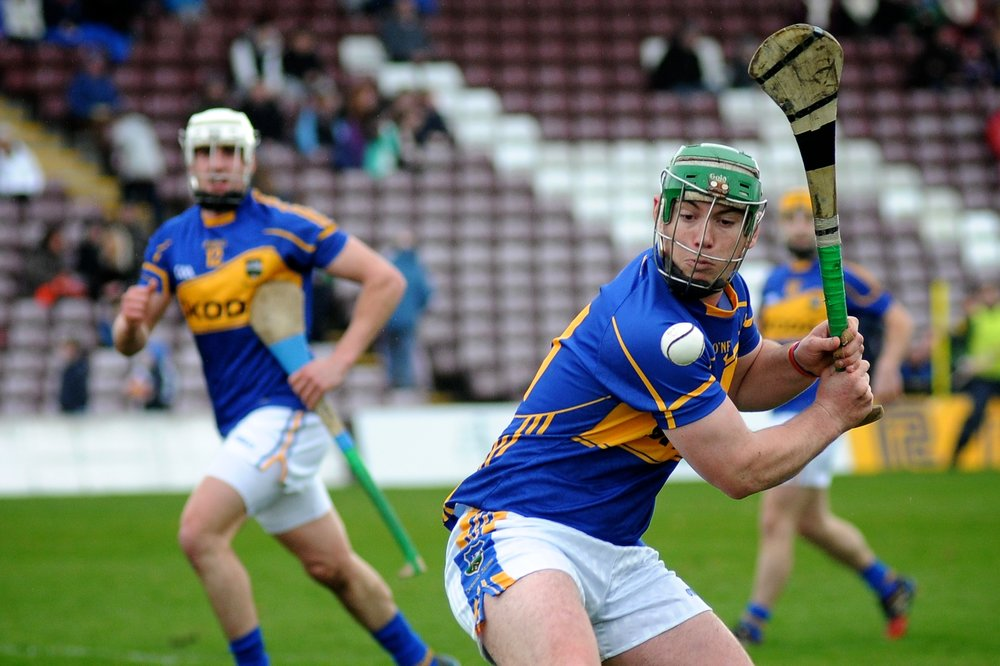John O'Dwyer plays in a game of hurling in the 2014 National Hurling League. (Credit: Seaninryan/Wikimedia Commons under CC-BY-SA 3.0)