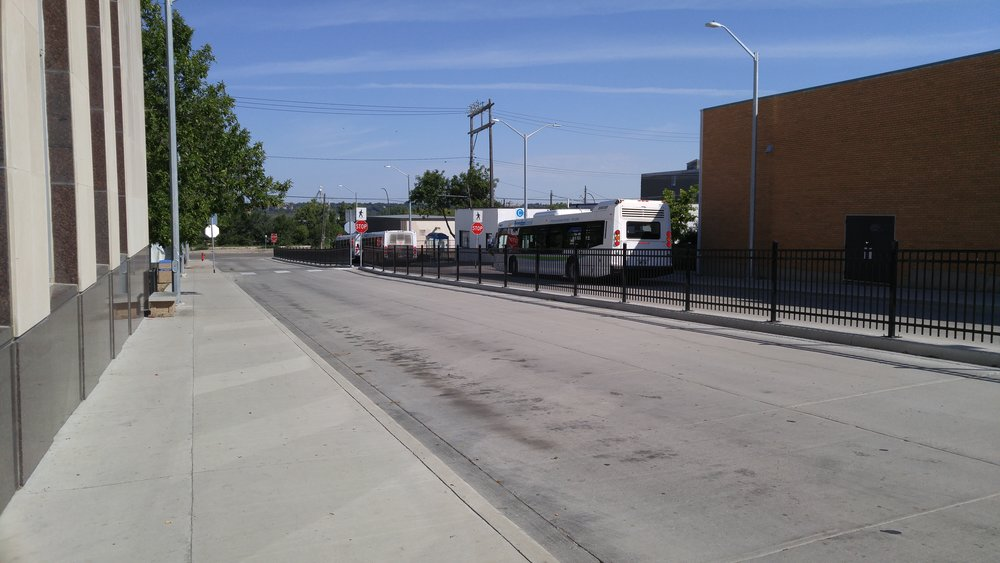 The open road calls to buses waiting at Brandon Transit's recently-renovated downtown terminal. (Logan Praznik/The Quill)