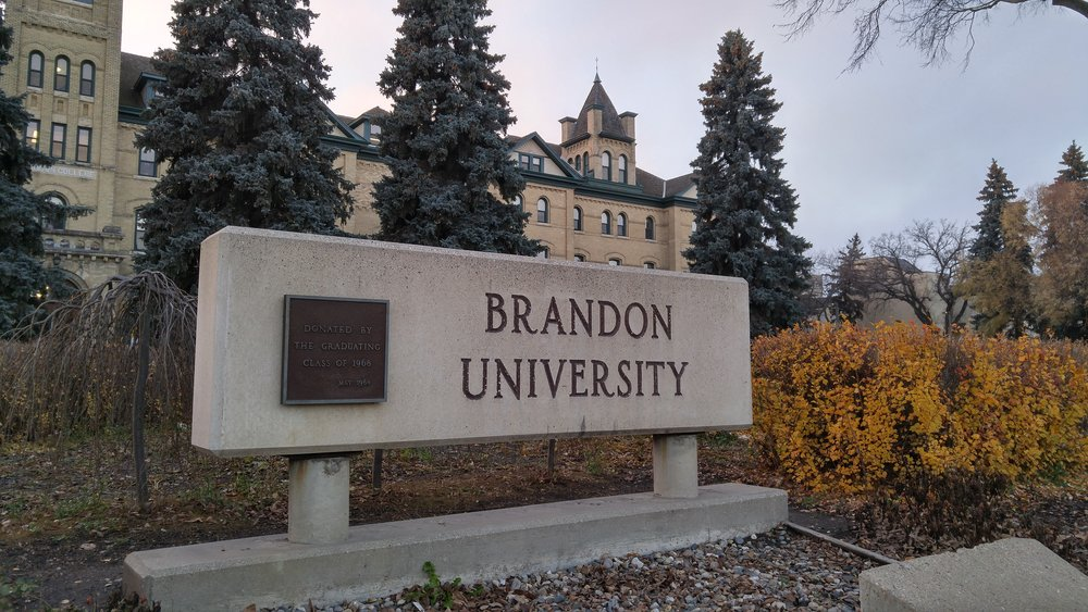 The Brandon University sign in front of Clark Hall. (Logan Praznik/The Quill)
