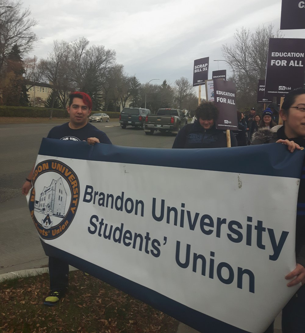 The march winding around 18th Street, led by BUSU council members. (Kai Neiman/The Quill)