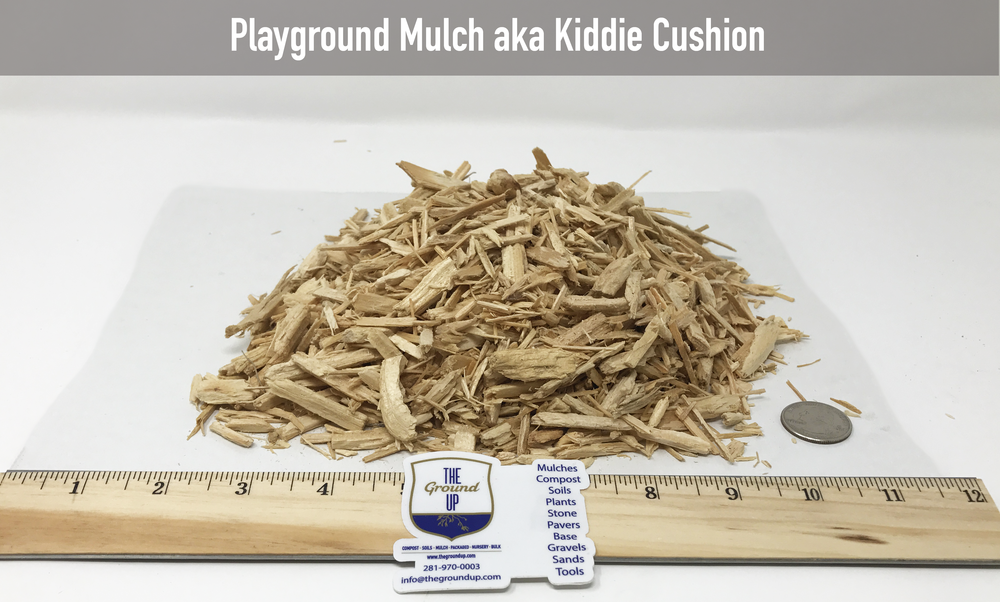 Chipped virgin Pine and/or Red Oak. This material is tested for playground applications.