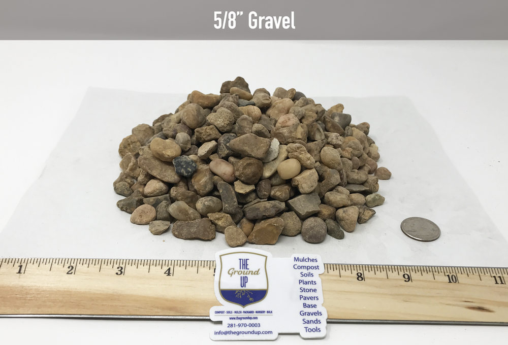 """5/8"""" Gravel   Commonly used on driveways and walkways. It has the fines for compaction so it will pack down and stay in place. Since it is small in size, it finishes off fairly smooth when leveled and compacted.   This product is also great for base material under flagstone, retaining walls, or concrete. It provides a firm base but deals better with water than Crushed Basalt will in these situations."""